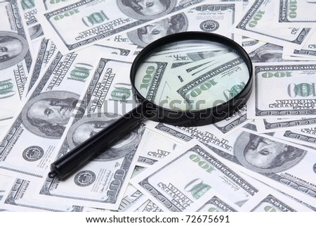 Money and a magnifying glass