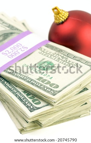 Money and Christmas Ornament on a White Background.