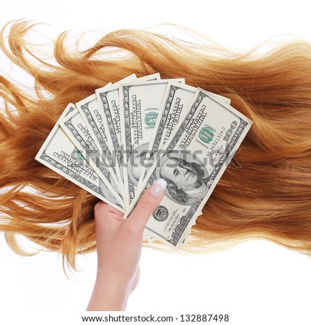 money and curly brown hair over white background, dollars bills in