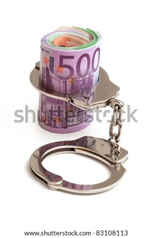money and handcuffs - stock photo