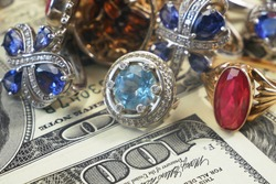 money and jewelry, pawn shop and buy and sell concept, golden rings, necklace bracelet, closeup