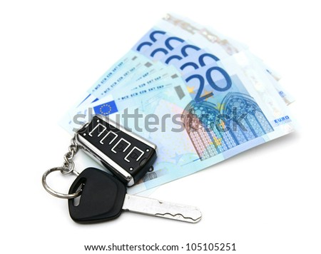Money and keys from the car. On a white background.