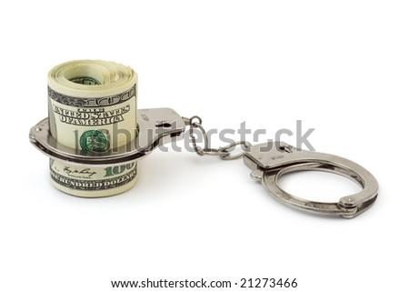 Money and manacles isolated on white background