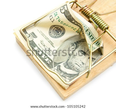 Money and mousetrap. On a white background.