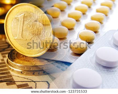 Money and  pills. Modern medicine concept.