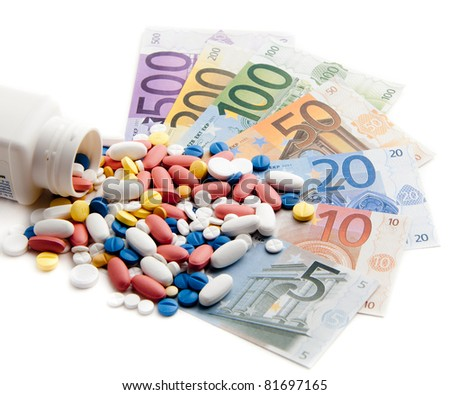 Money and pills. Pills of different colors on money.