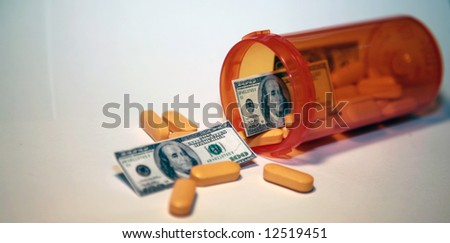 Money and pills pour out of a pill bottle representing the high cost of health care and medication concepts - stock photo
