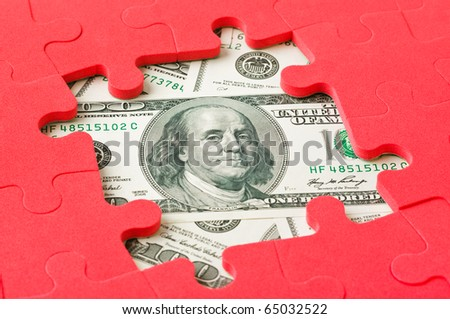 Money and red puzzle - business concept