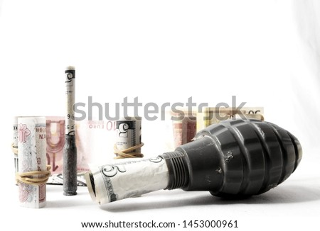Money and Weapons Concept Weapons and Money on a White Background #1453000961
