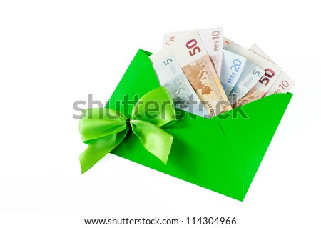 Money as a gift with green bow and green envelope on white background