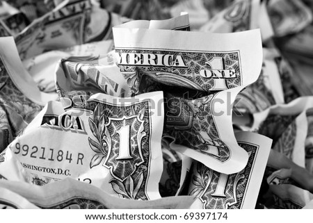Money background with crumpled one dollar bills.  Black and white macro with shallow dof.
