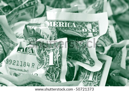 Money background with crumpled one dollar bills toned in green.  Macro with shallow dof.