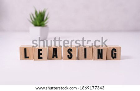 Money bag and blocks with the word Leasing. A lease is a contractual arrangement calling for the lessee to pay the lessor for use of an asset. Property, vehicles are common assets that are leased Imagine de stoc ©