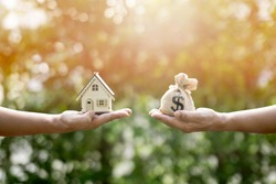 Money bag and houses show savings to buy a home or buy real estate. Or show a home loan Or divide the investment for retirement. Or for the future Concept of money