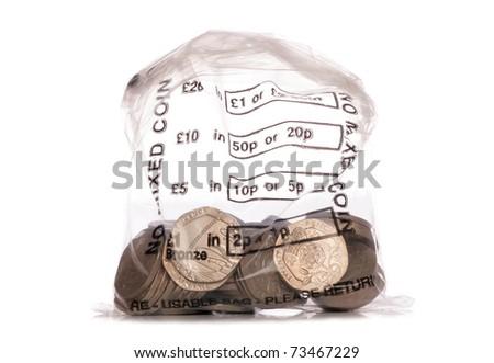 Money bag of sterling twenty pence coins studio cutout - stock photo