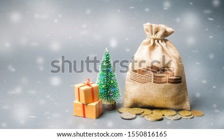 Money bag with coins and snowfall with tree. Business and finance. Loans, deposit, credit. New Year promotions and Christmas. Accumulation of money. Savings. Winter season