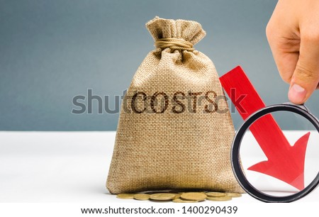 Money bag with coins with the word Costs and a down arrow. Reduction. Expenses cut. The concept of business and finance. Money Management. Budget planning. Revenue analysis. Distribution of funds #1400290439
