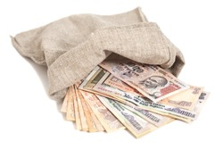 Money bag with Indian Currency Rupee bank notes on white background