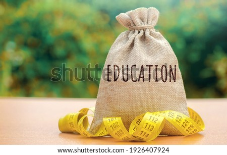 Money bag with the word Education. The concept of saving money for studies. Investments of budgetary funds in the educational system, a policy of improving quality of education Stock photo ©
