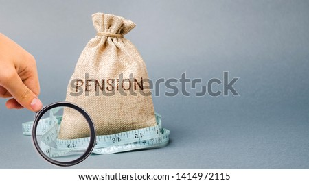 Money bag with the word Pension and tape measure. Fall / reduction pension payments. Retirement. Financing retirees. Reduction of the pension fund. The low size of pensions. Poverty. Lack of money #1414972115