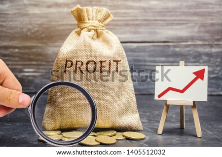 Money bag with the word Profit and an up arrow. Concept of business success, financial growth and wealth. Increase profits and investment fund. Saving money and accumulation. #1405512032