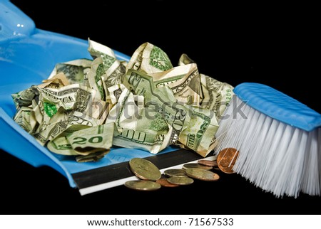 money being swept in dust pan