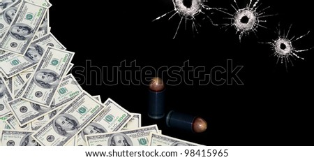 money, bullets and bullet holes on the black background - stock photo