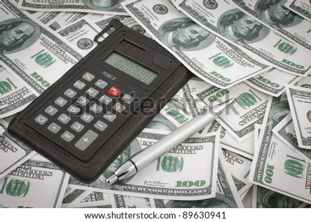 money calculator and pen background photo