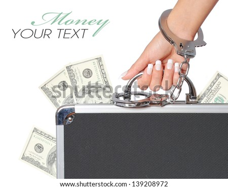 Money, case of dollars bills in female hand with handcuffs, isolated on white. concert