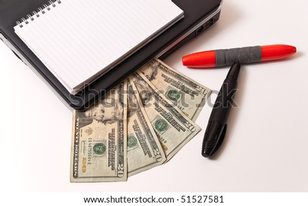 Money Clipped Inside Computer with Pens and Notebook