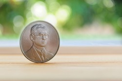 Money coin thai currency  on the wood background;king of thailand.