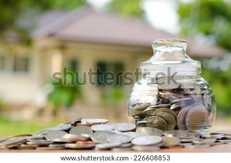 money coins with home, Saving for buy home concept