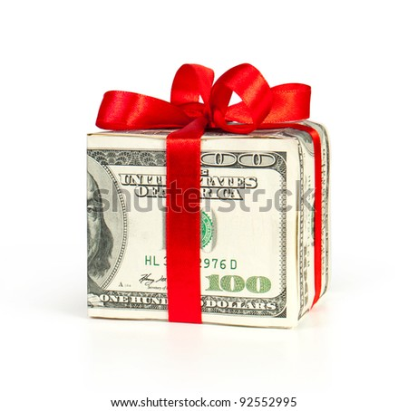 Money concept dollars in the form of a gift box isolated on white