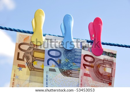 Money concept showing Euro banknotes on washing line