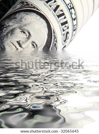 Money concept showing US Dollar sinking in water