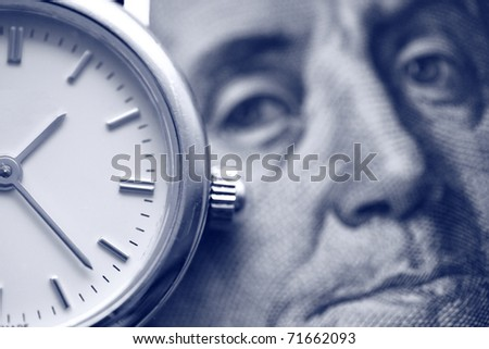 money concept: watch and portrait of Benjamin Franklin on the one hundred Dollar bill