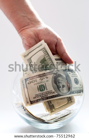 money concept with dollars and hand