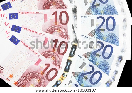 Money - Details Of 10 And 20 Euro Notes Laid Out As Fan - stock photo