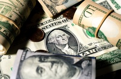 Money, Dollar bills background. Dollar bills in a gloomy environment. Finance and Economy concepts.
