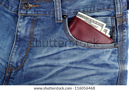 money dollars and brown leather wallet in jeans in front pocket blue color background