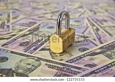 Money dollars and lock - symbol of protection of savings and money symbol bank collection, frozen accounts, insurance, trust, reliability, confidence