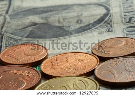 Money -  euro coins on one dollar banknote