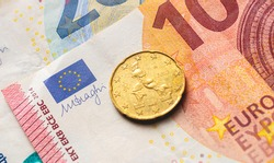 Money, Euro - EUR. A 20 Euro cent on a Euro banknotes in close up Photo.