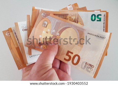 money euro euros banknotes fifty 50 for background economy buy sell salary income saving pensions Foto stock ©