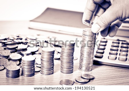 Money, Financial, Business Growth concept, Close-up Of Businessman Hand Count and Put Money Coins To Stack Of Coins