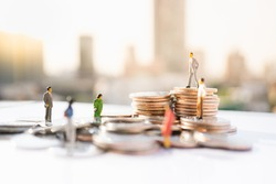 Money, Financial, Business, teamwork or Growth concept, Miniature figures businessmen stand on stack of coins