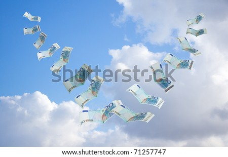 money flying away into the sky