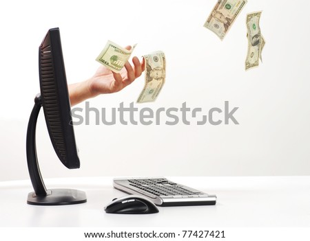 money flying out of computer monitor