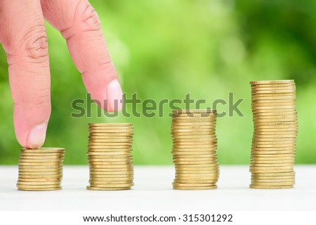 Money Gold coin Steps with green bokeh background ,Business Finance and Money concept