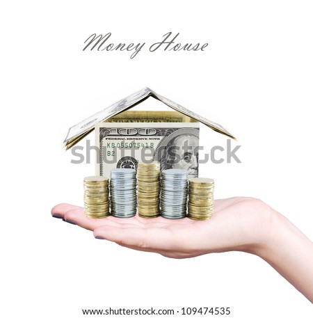 Money house on the hand isolated on white background